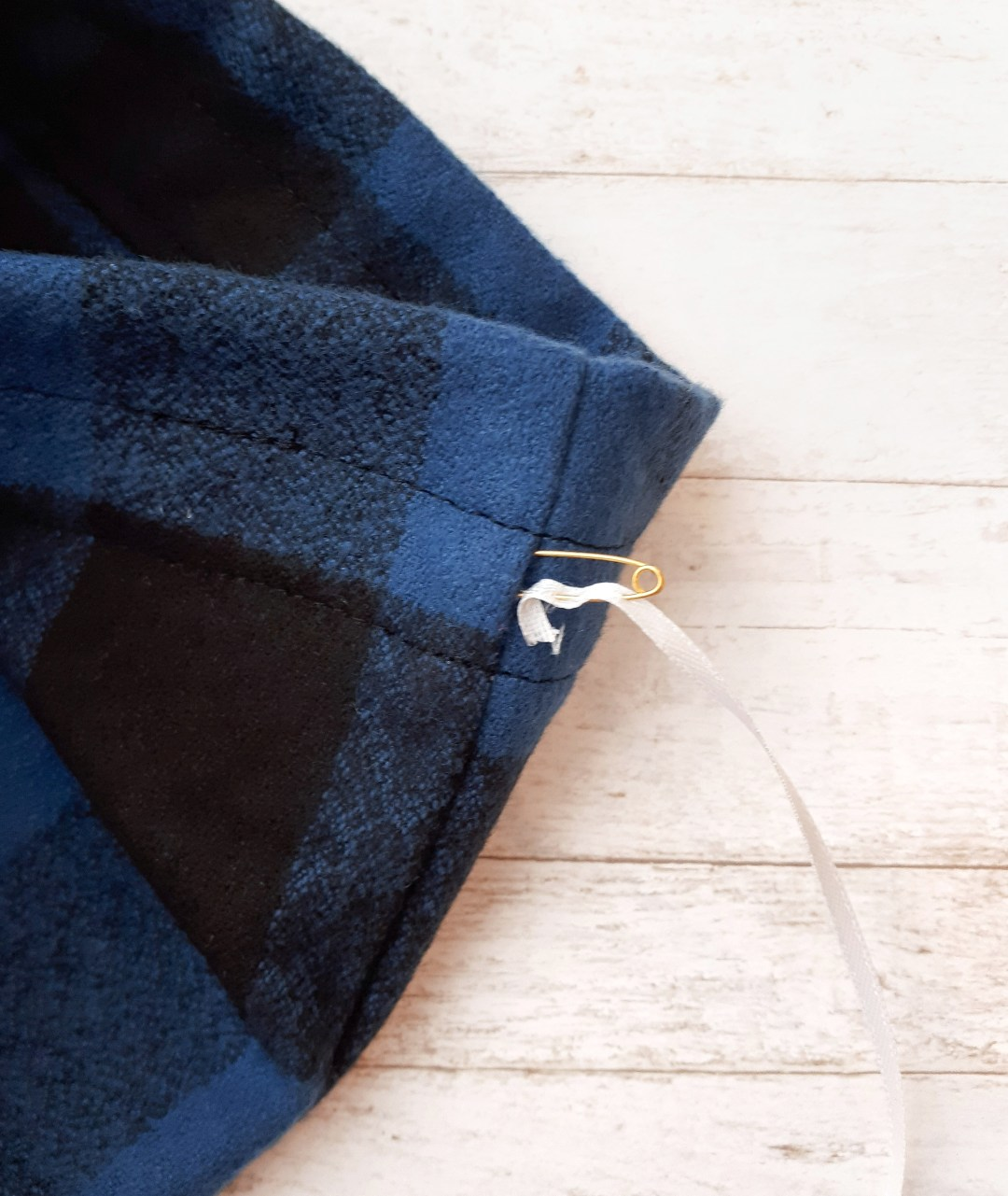 Use a safety pin to thread the ribbon through the casing