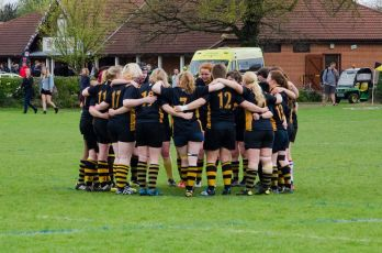 Roses2015 rugby review huddle