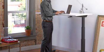 Man using desk while standing up