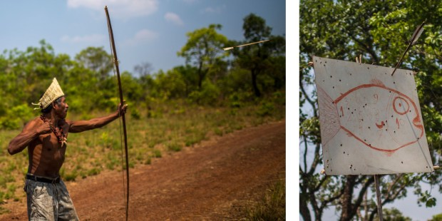 A Xerente indigenous man trains with bows and arrow for the Indigenous Games at his village near Tocantinia, Brazil, Friday, October 2, 2015. Right: A bow hangs on a makeshift target with a fish painted on it at  Xerente indigenous village near Tocantinia, Brazil, Friday, October 2, 2015. Credit: Dado Galdieri for the Wall Street Journal