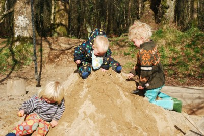playing in the sandpit at the yurt farm