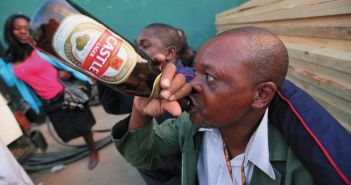BEER SALES SURGE—A man drinks a beer in Harare