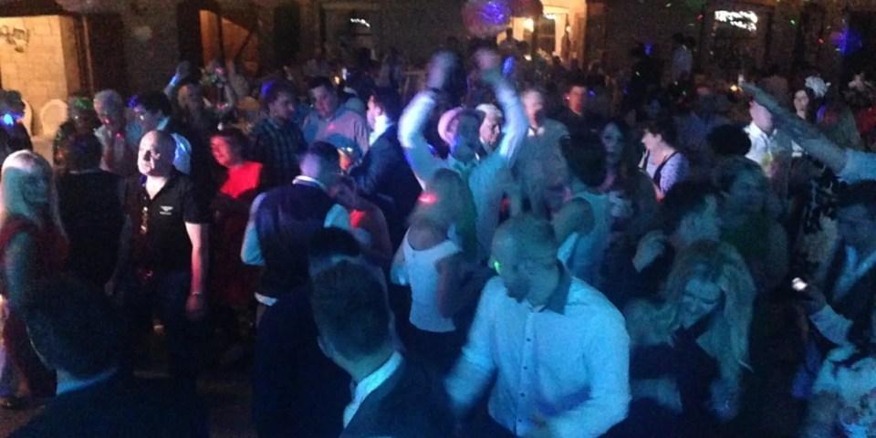 wedding guests, wedding party, barn wedding, Berekley Barn, Barn wedding Gloucestershire, wedding  venue in Gloucestershire, May wedding, Wedding Reception, People dancing, Bride and Groom,