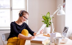 A,Young,Female,Student,Sitting,At,The,Table,,Using,Tablet