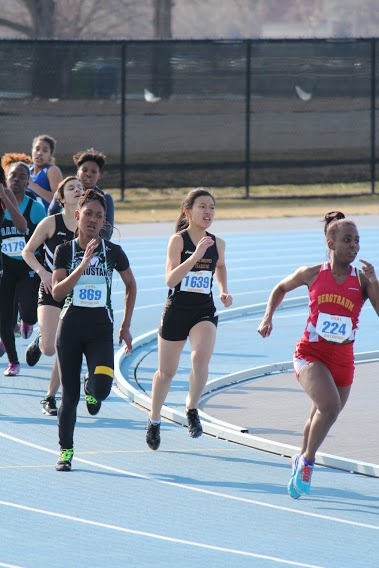 Senior Esther Jou races to the finish line. Photo by Yash Sharma.