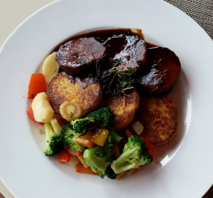 Lamb shank, in a red winde jus, polenta and vegetables