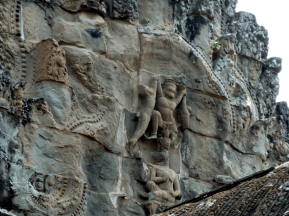A carving high on the walls of Angkor Wat.