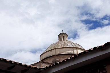 A church dome rises into the sky.