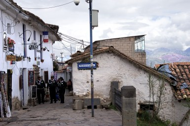 Police officers patrol one of Cusco's most popular tourist neighborhoods.