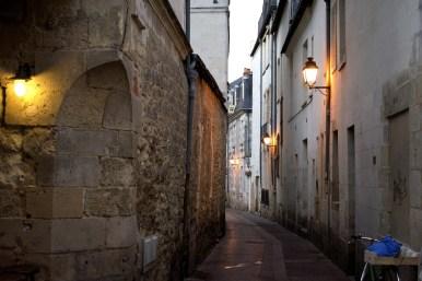 A lamplit alley.