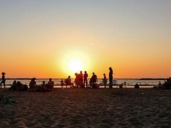 Sunset on the beach in Tel Aviv.