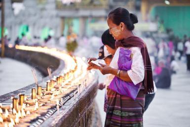 Women saving prayers at Schwedagon Pagoda in Yangon, Myanmar (aka Burma)