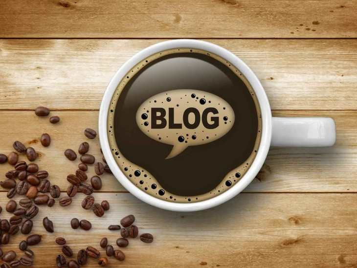 coffee cup with the word blog written in foam