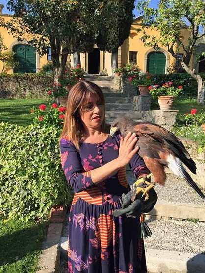 """Head Chef Silvia Baracchi with the falcon at """"Il Falconiere"""" in Cortona, Tuscany."""