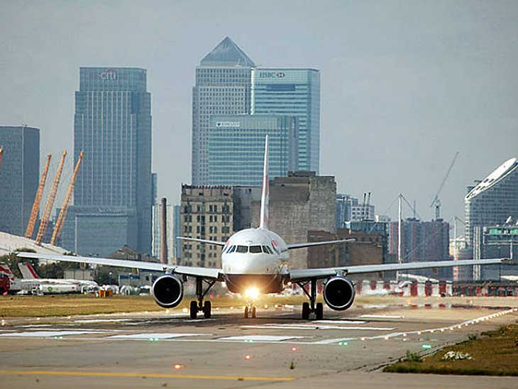 BA A318 on the runway at London City Airport.