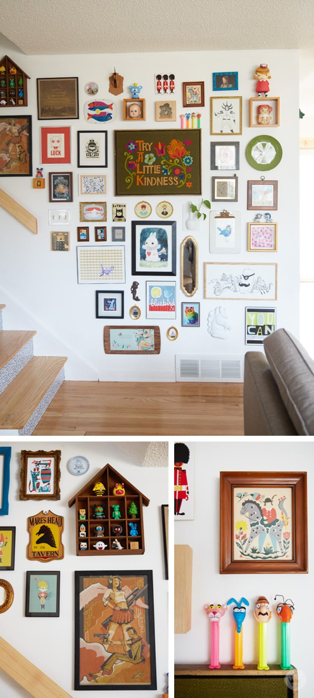 """Tips for displaying art: """"Collage wall"""" by a stair case featuring sculptures, prints, embroidery, shadowboxes, collectibles, and other pieces of art"""