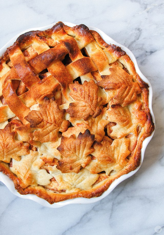 Cheddar Thyme Apple pie with a beautifully browned, combination lattice and cut-out-leaves crust.