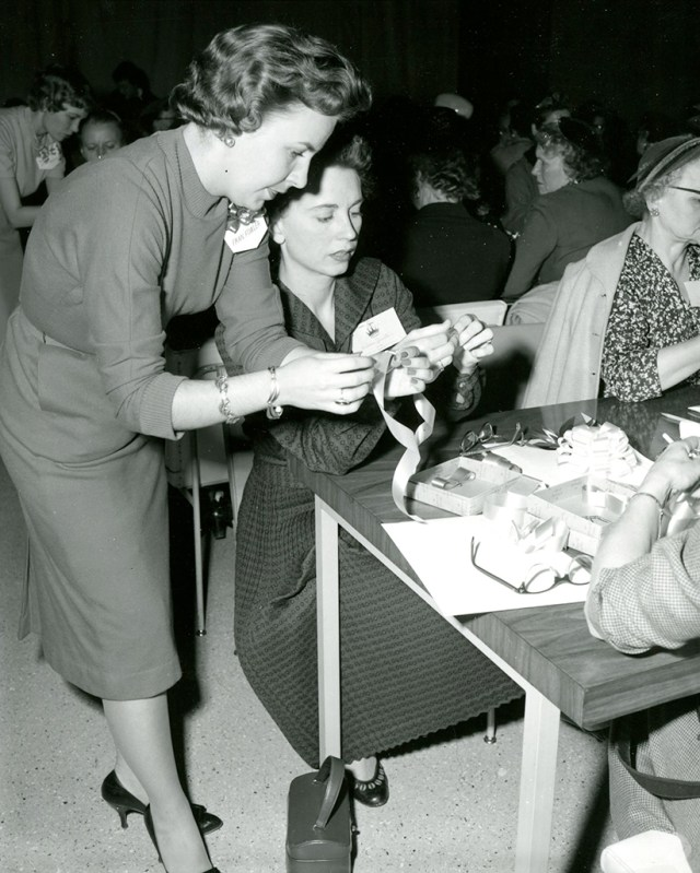 Kaye King helps a Hallmark gift wrap contestant finish her submission, c. 1956.