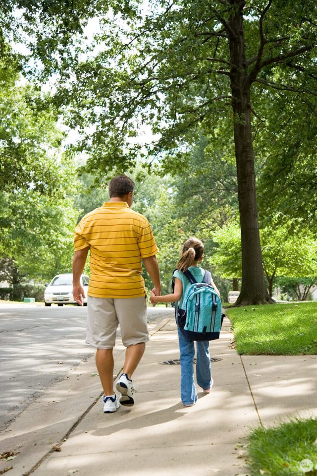 Back-to-school picture ideas: girl walking down the street with Dad