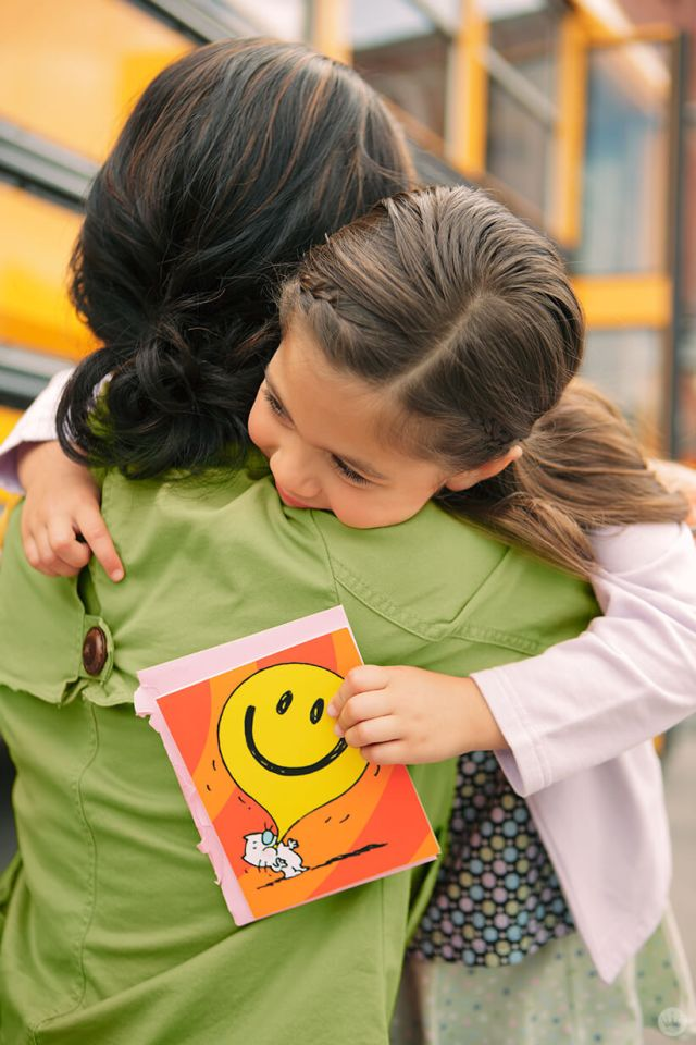 Back-to-school picture ideas: woman hugging child