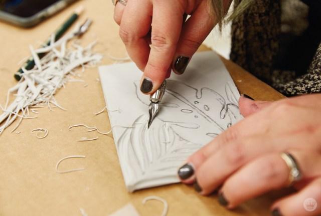 Cutting a linoleum block in a Hallmark linocutting basics workshop