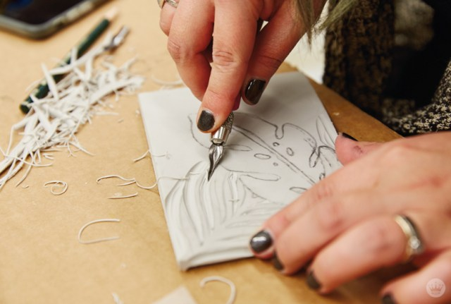 Cutting a linoleum block in a Hallmark linocutting basics workshop