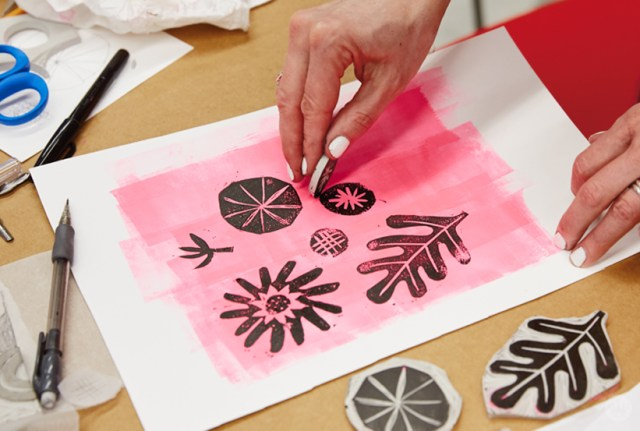 Linocut prints on a painted background
