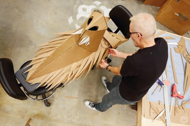 Hallmark artists explore cardboard Halloween costume ideas. Matt K works on his wolf.