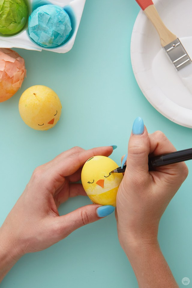 Drawing a chick on a decorated egg | thinkmakeshareblog.com