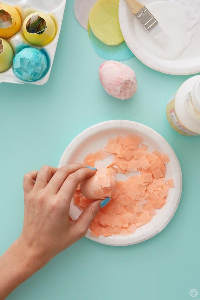 Covering glue on a confetti-filled egg | thinkmakeshareblog.com