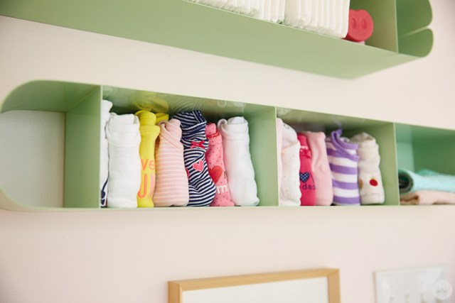 CD cases are used to hold diapers and onesies.