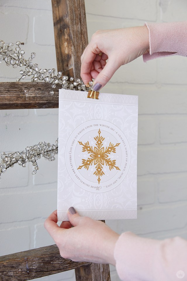 Adding a card to the Wooden Ladder Christmas Card Display