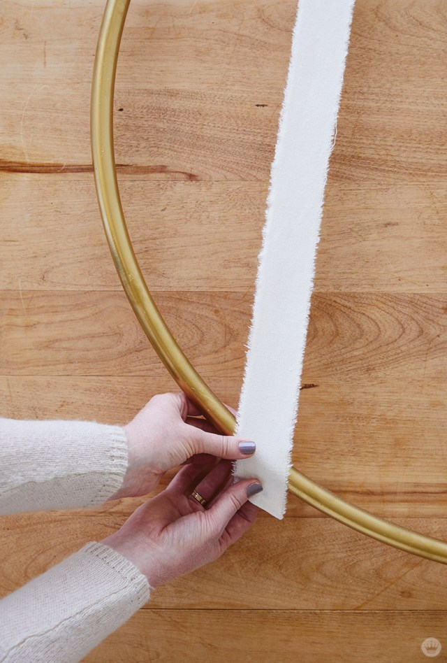 Fitting ribbon to a Gold Hoop Christmas Card Display