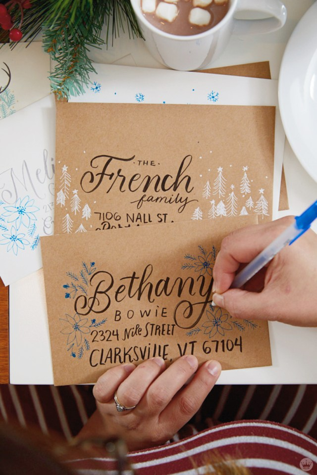 Christmas Card Challenge: artist hand addressing envelope