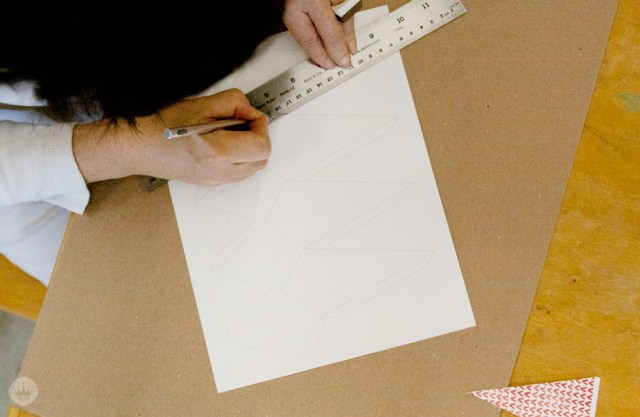 Cutting the template for your DIY Christmas paper ornaments.