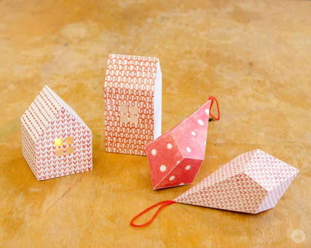 Red and white patterned paper ornaments on tabletop.