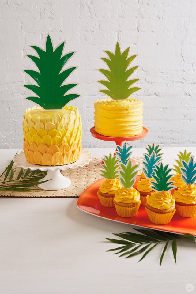 Brush stroke ombré pineapple cake with paper topper—and another cake and cupcakes