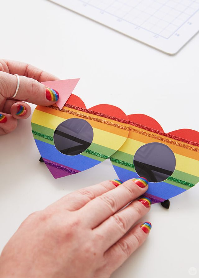 Attaching the pink triangle to the DIY Pride Sunglasses | thinkmakeshareblog.com