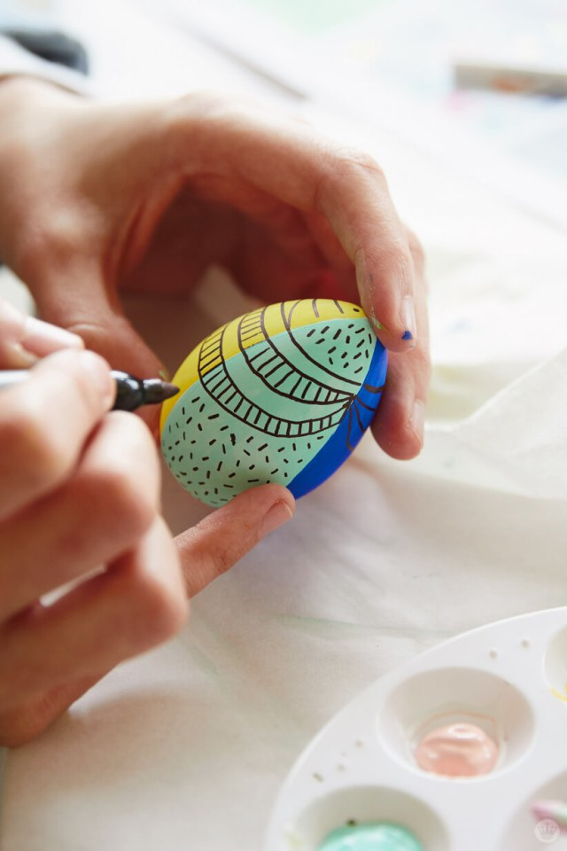 Decorating an Easter egg with permanent marker