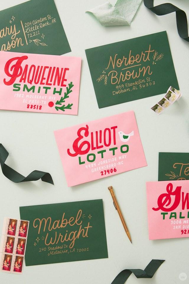 Hand lettered addresses on dark green and pink envelopes. | thinkmakeshareblog.com
