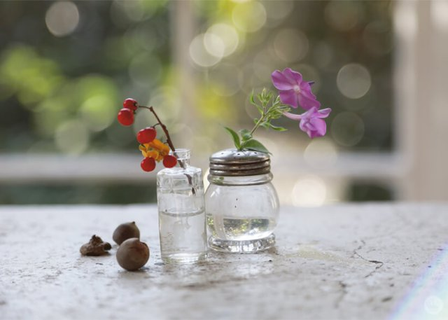Fall foliage in tiny glass containers