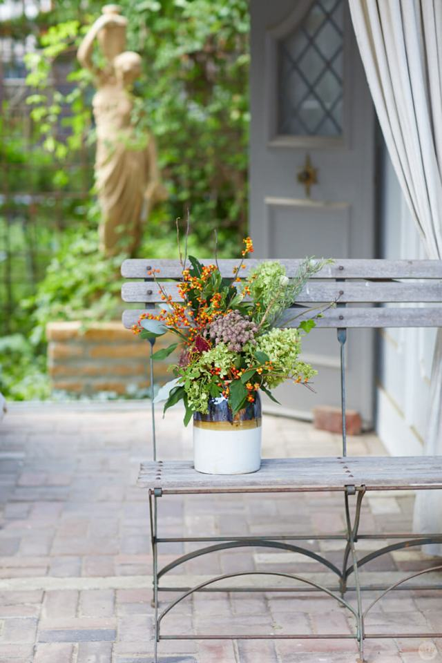 Fall flower arrangement on a wooden bench