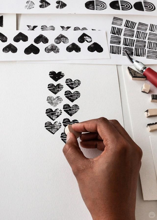 Hallmark artist Alyissa J. stamping a linocut heart on paper for free February 2019 digital wallpapers | thinkmakeshareblog.com