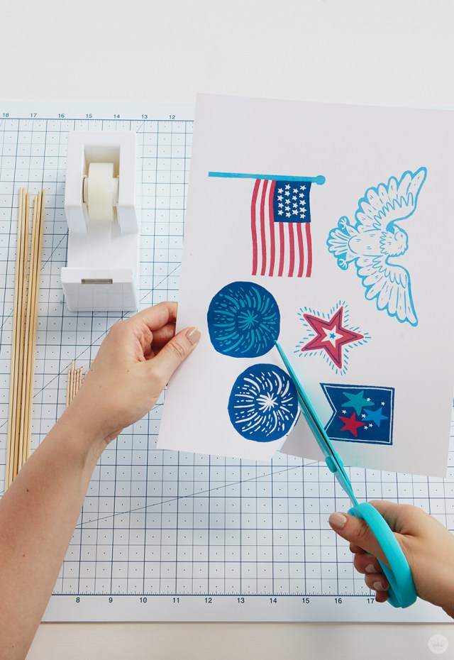Cutting out fireworks topper design.