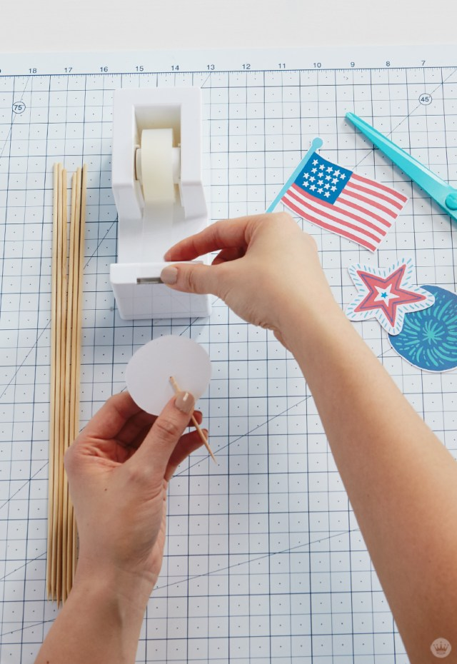 Taping toothpick to back of patriotic topper