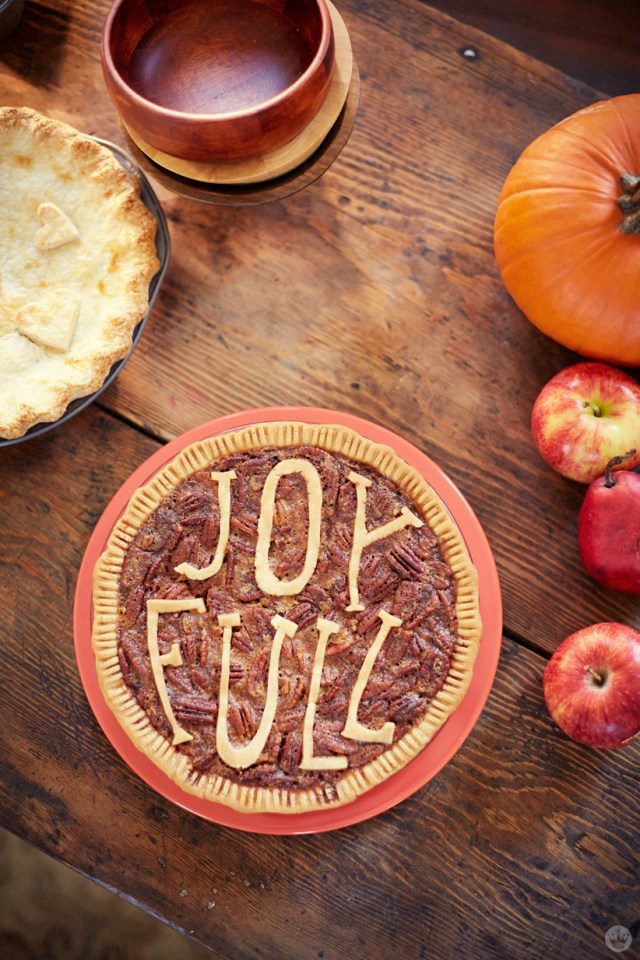 Pecan pie with JOY FULL spelled out in crust