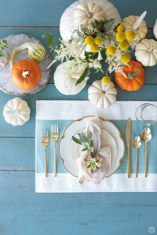 Place setting with pumpkin centerpiece