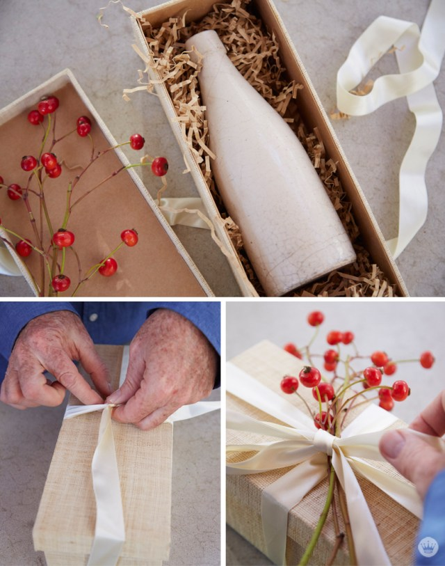 Easy holiday gift giving tips from a Hallmark stylist. Red berries to adorn gift box with vase inside.