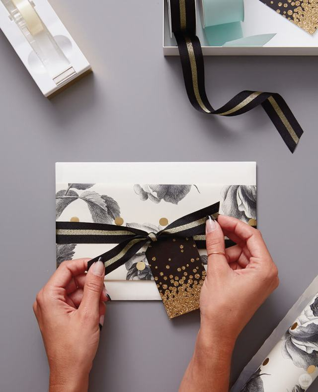 Wrap a wedding present by dressing up a gift card envelope with gift wrap | thinkmakeshareblog.com