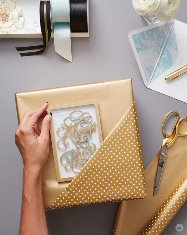 Wrap a wedding present featuring a pocket fold with the card as the star design element | thinkmakeshareblog.com